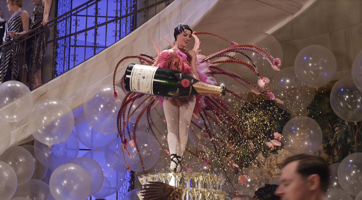 The-show-stopping-party-scene-in-the-movie-The-Great-Gatsby-with-a-dancer-holding a larger-than-life Moët Impérial bottle_veryhigh.width-9500x-prop